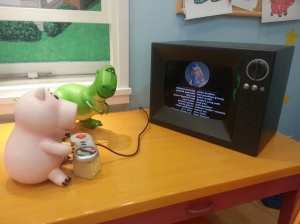 In case you don't recognise it, they're watching Toy Story 2.