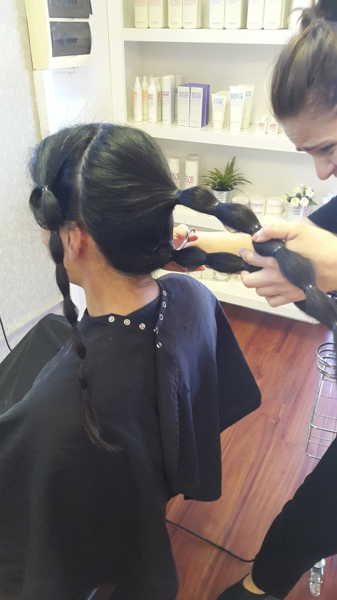 It took her upwards of a dozen cuts to get through each ponytail.